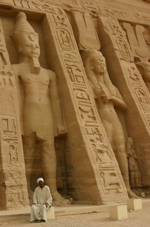 Temple guardian before the larger than life Ramses