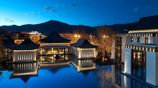 The St. Regis Lhasa Resort qith views of the resort's lake and the Himalaya Palace.