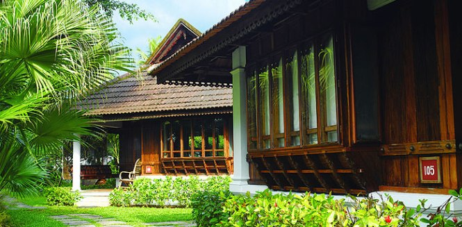 Kumarakom Lake Resort portrays a perfect blend of Kerala's traditional architectural charm and luxurious modern amenities at Kumarakom. The resort is a reconstruction of manas, the 16th century traditional homesteads of God's Own Country. Over a hundred ancestral homes had been purchased from across Kerala, dismantled and used to provide much of the material to create these authentic heritage abodes. Kumarakom, an enchanting village situated on the banks of the Vembanad Lake is wrapped in a quaint charm all its own.