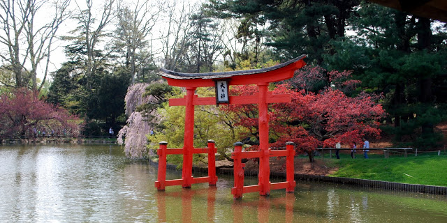 The Torii, or gateway, indicates there is a Shinto shrine in the area dedicated to the god of the harvest, protector of plants.