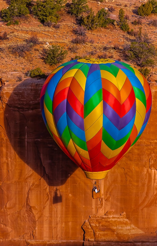 Aerial view of hot air balloons flying during the Red Rock Balloon Rally, Red Rock State Park, near Gallup, New Mexico USA