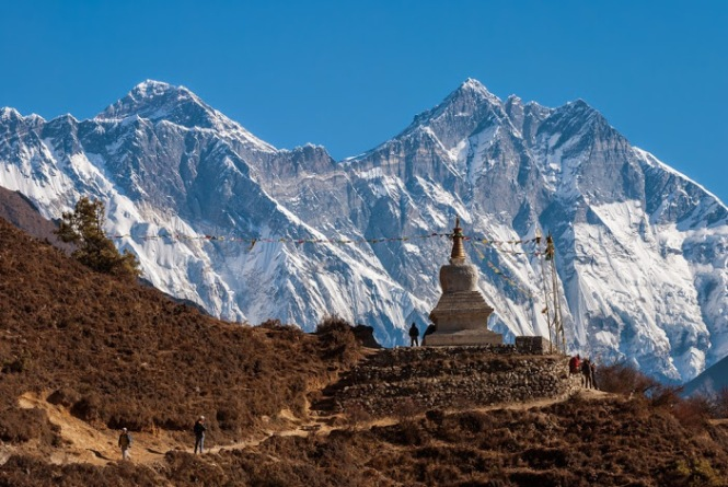Buddhist stupa with Lhotse wall ( 6800m - 8000 m  22300 ft - 26300 ft.) and Mt. Everest in background, Nepal.