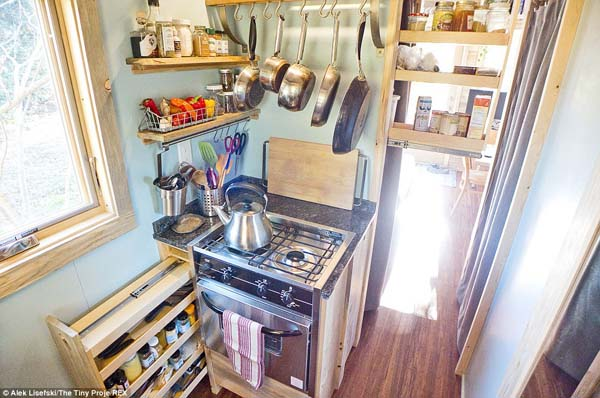 Slide-out drawers hide pantry shelves and spices